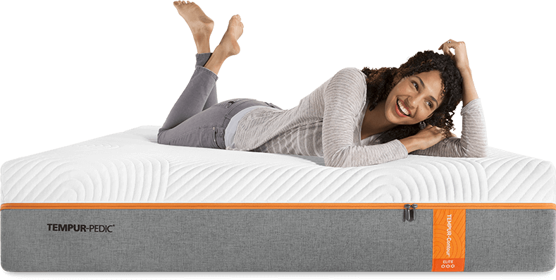 Woman lying on a Tempur-pedic memory foam mattress