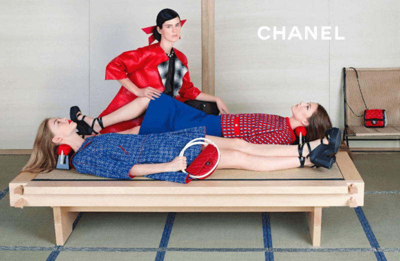 chanel ad from 2013 campaign featuring blue and red clothes, three models, and two takamakura geisha pillows