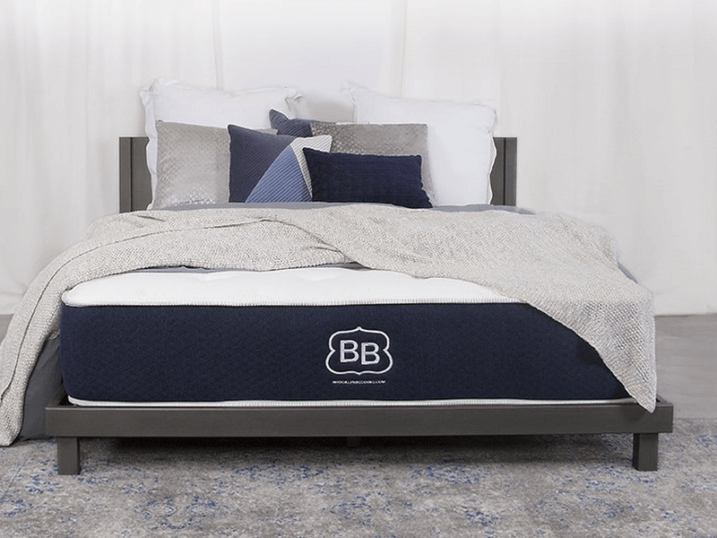 Brooklyn Bedding mattress with gray bedsheet and pillows
