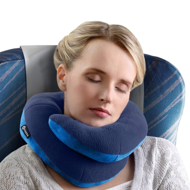BCOZZY Chin Supporting Travel Pillow used by sleeping woman on airplane seat