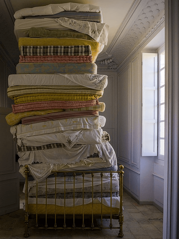 A large stack of old mattresses