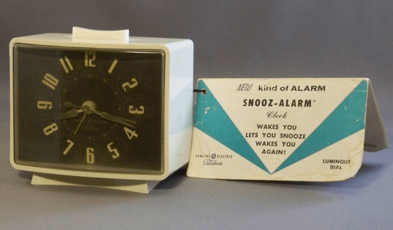 A vintage clock with a snooze alarm