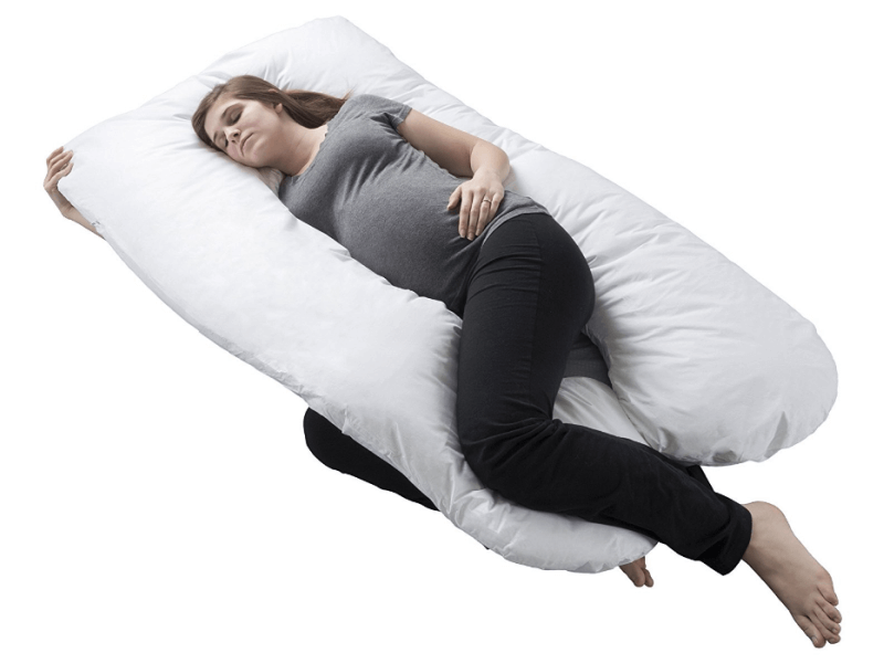 pregnant woman using full length u-shaped body pillow while sleeping