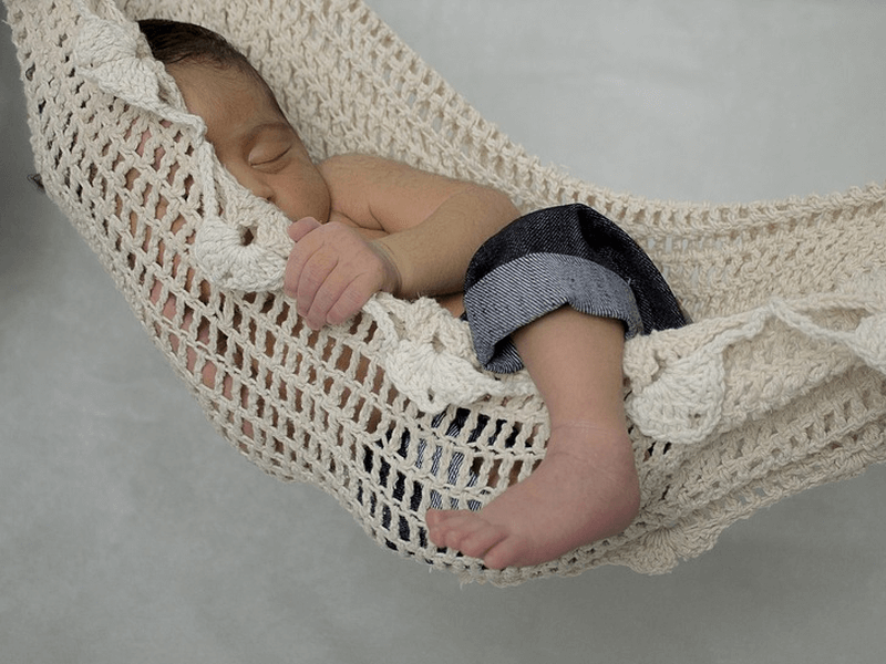 baby sleeping on hammock