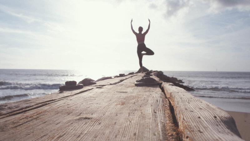 Yoga meditation on a pier
