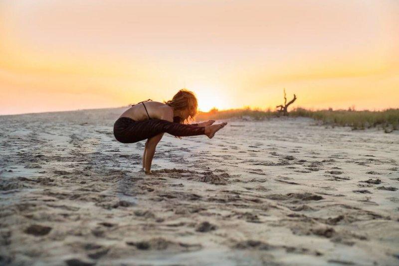 Yoga meditation on a beach