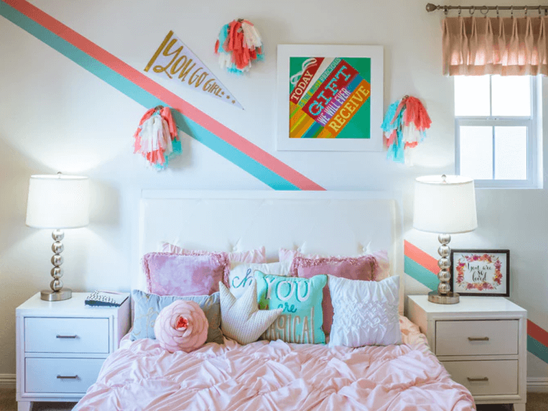 A not-so-feng-shui-friendly bed with brightly colored pillows and bedsheets