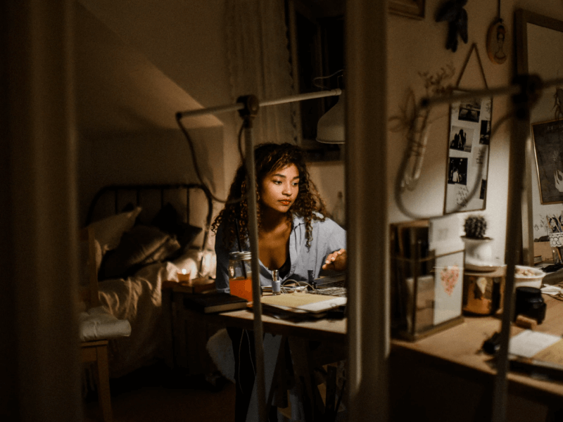 A cluttered bedroom keeping a woman awake