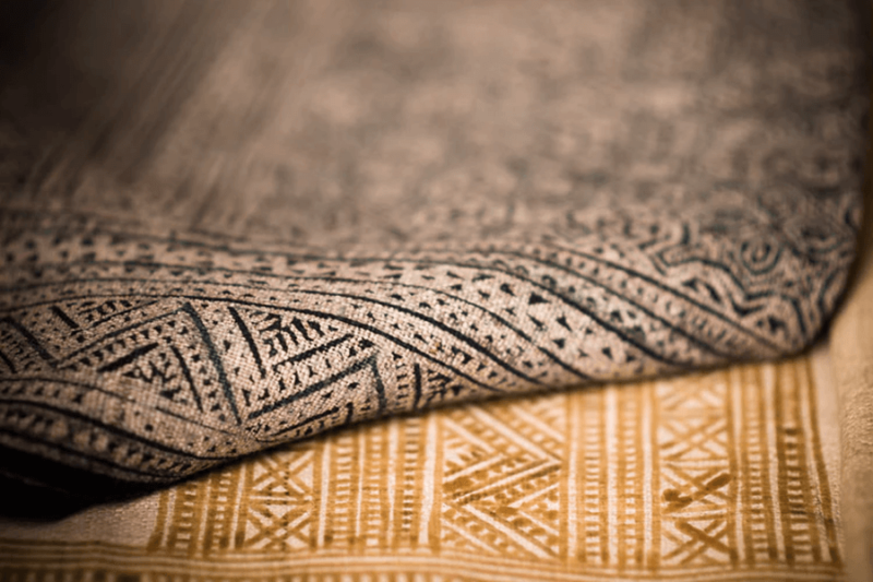 A close up view of patterned rugs