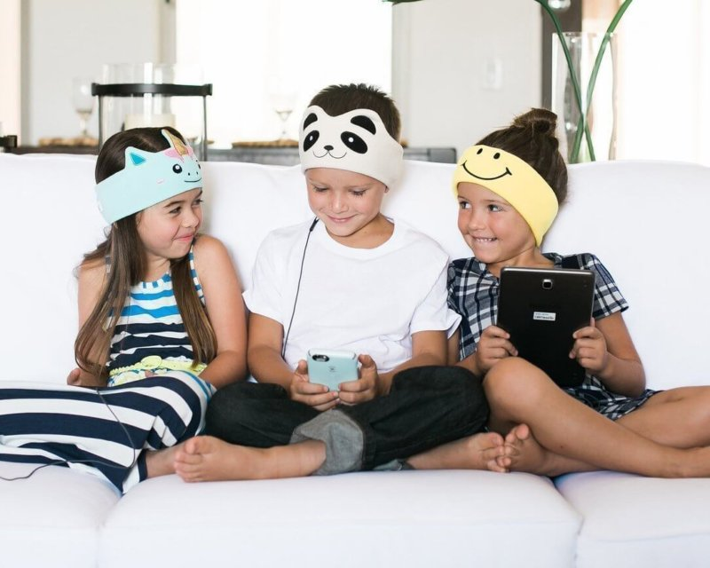 three children wearing Cozyphones
