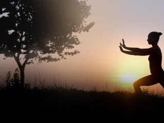 woman practicing qigong meditation