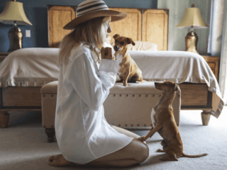 woman and dogs in bedroom