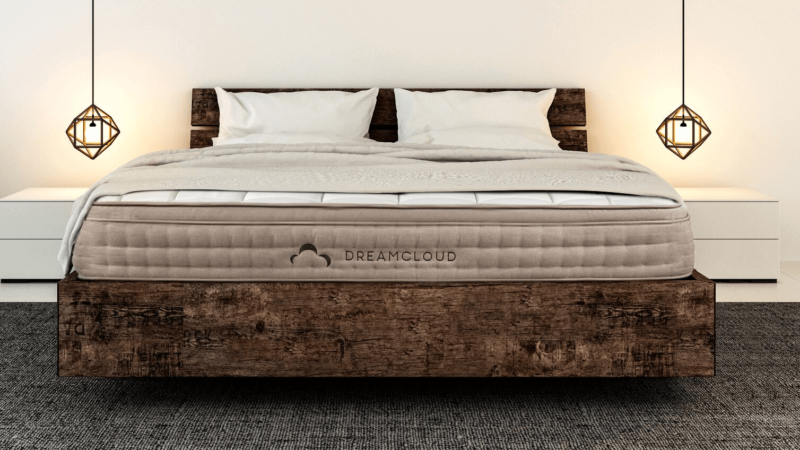 Dreamcloud mattress on weathered wooden frame