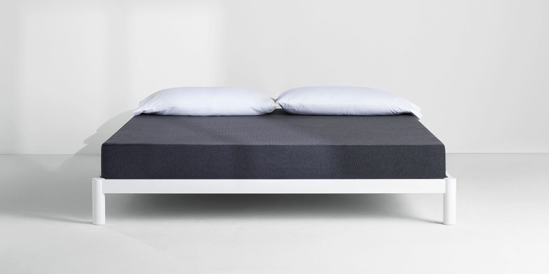 Casper Essential mattress on bed frame with pillows