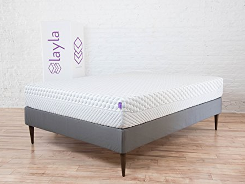 Layla Mattress on bed frame next to delivery box