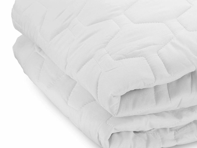 the grand mattress pad against white background