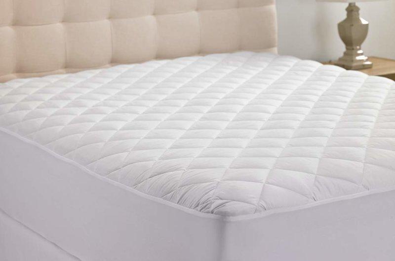 Hanna Kay mattress pad on bed