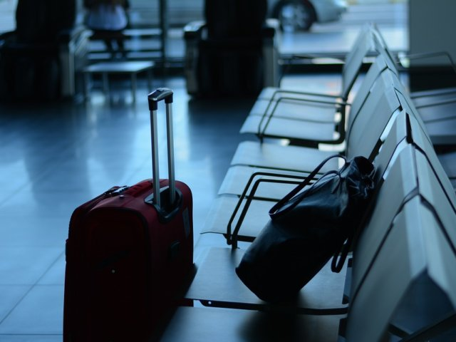 carry-on-luggage-near-airport-seats