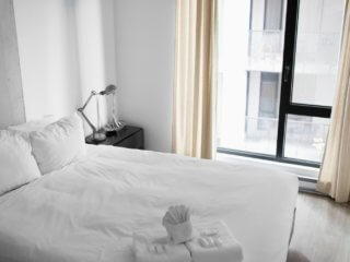 white towels and linens on bed